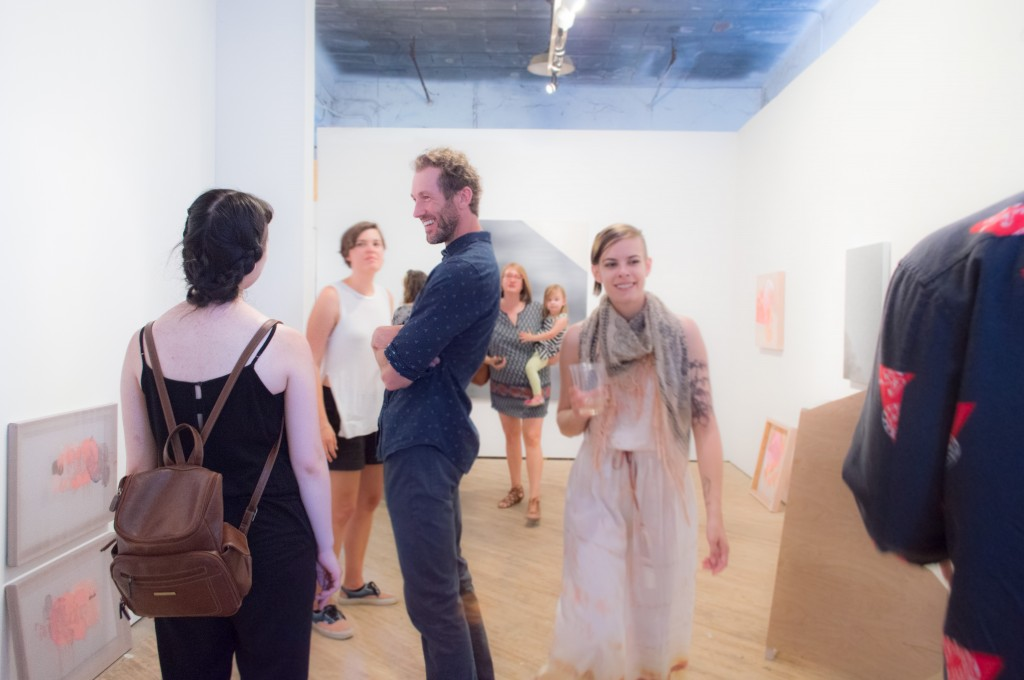 Nathan chatting it up with visitors at Amiable Strangers opening